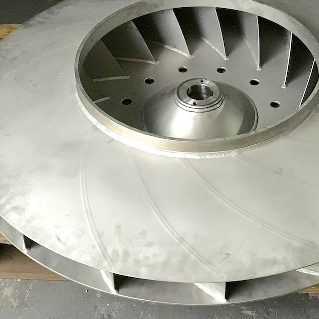 Custom fabricated stainless steel fan hub